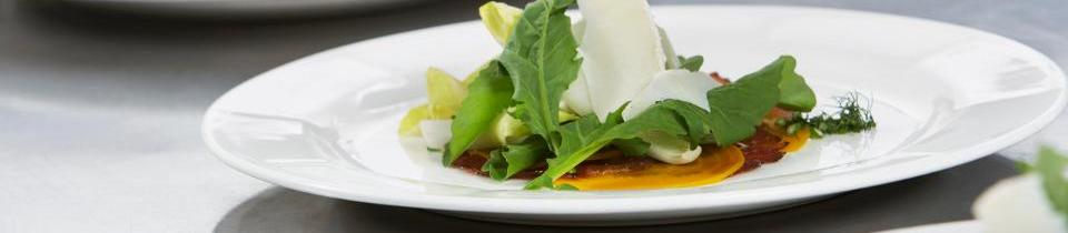 Goats cheese and rocket on a white plate